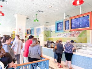 bustling ice cream parlor with a long line Disney Boardwalk
