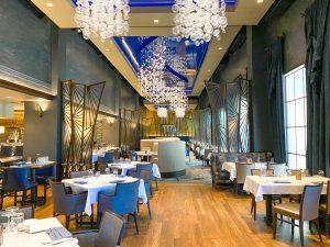 elegant restaurant interior with chandeliers and white table cloths Disney Boardwalk