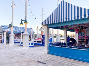 waterfront blue and white striped booths with boardwalk games