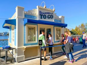 small waterfront booth with short line Disney Boardwalk