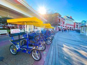 line of surrey bikes along the Disney Boardwalk