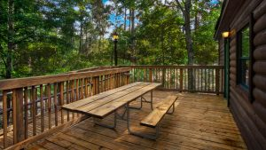 wooden cabin patio with picnic table Disney World resorts