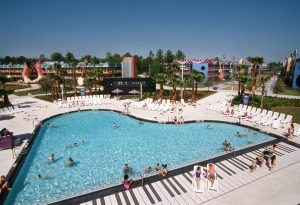 piano-shaped pool filled with people Disney World resorts
