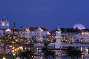 blue and white buildings lit up at dusk Disney World resorts