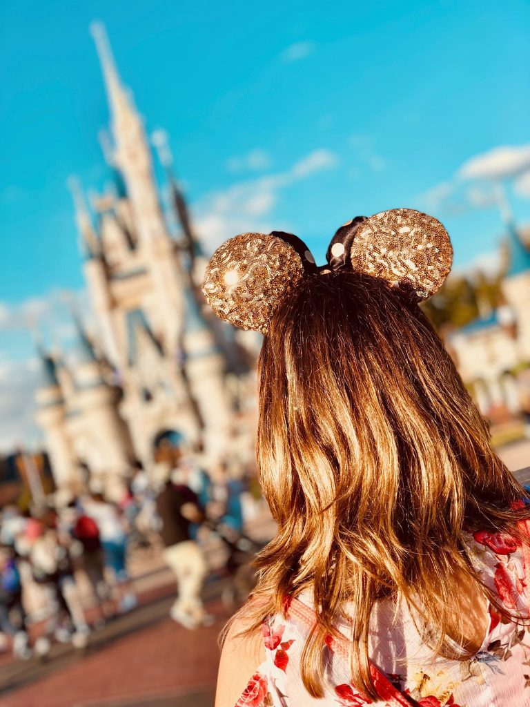 Disney on a Budget Girl with Ears in front of Castle