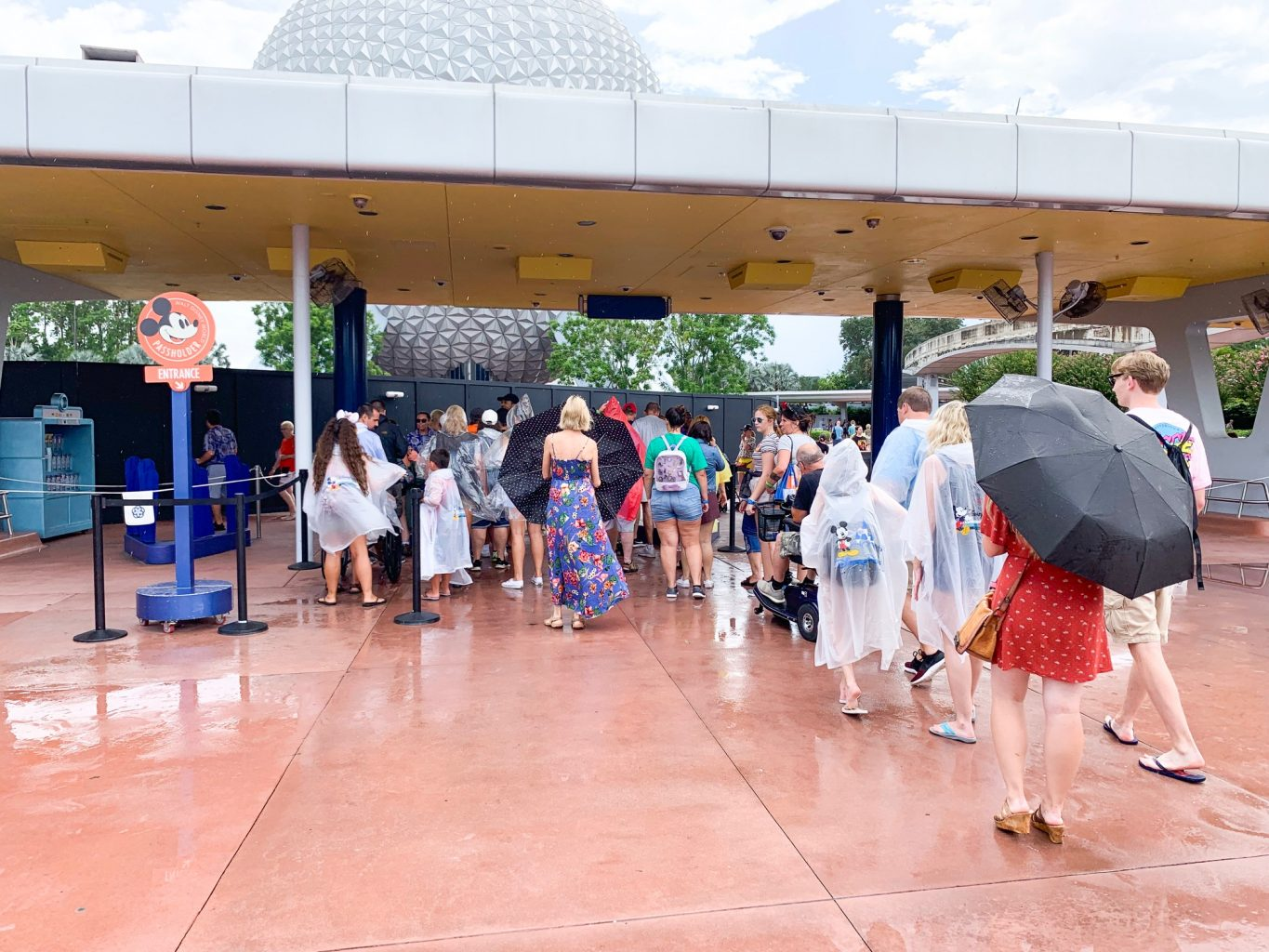Disney on a Budget People in Rain in Ponchos