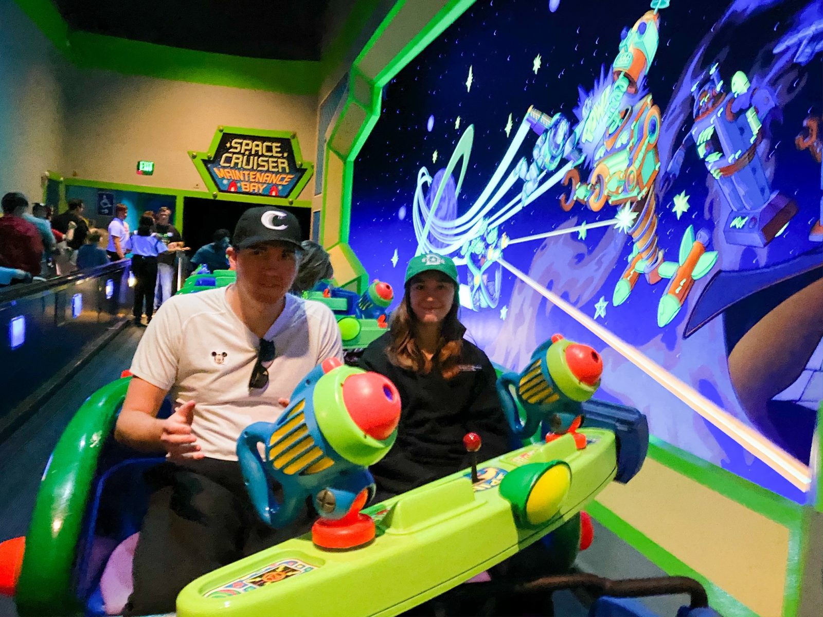 people on Buzz Lightyear Space Ranger Spin