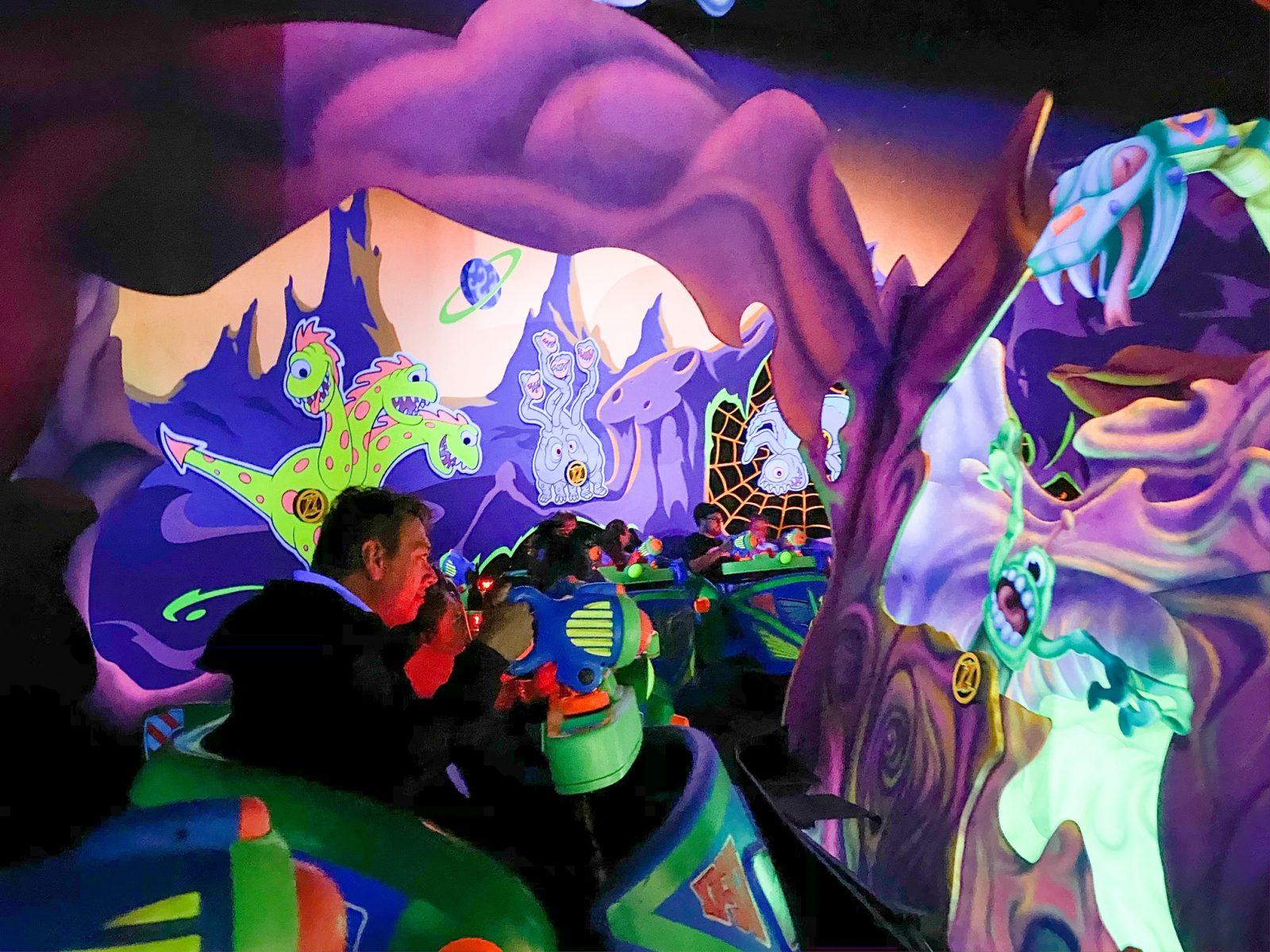 people scoring on Buzz Lightyear Ride at Magic Kingdom