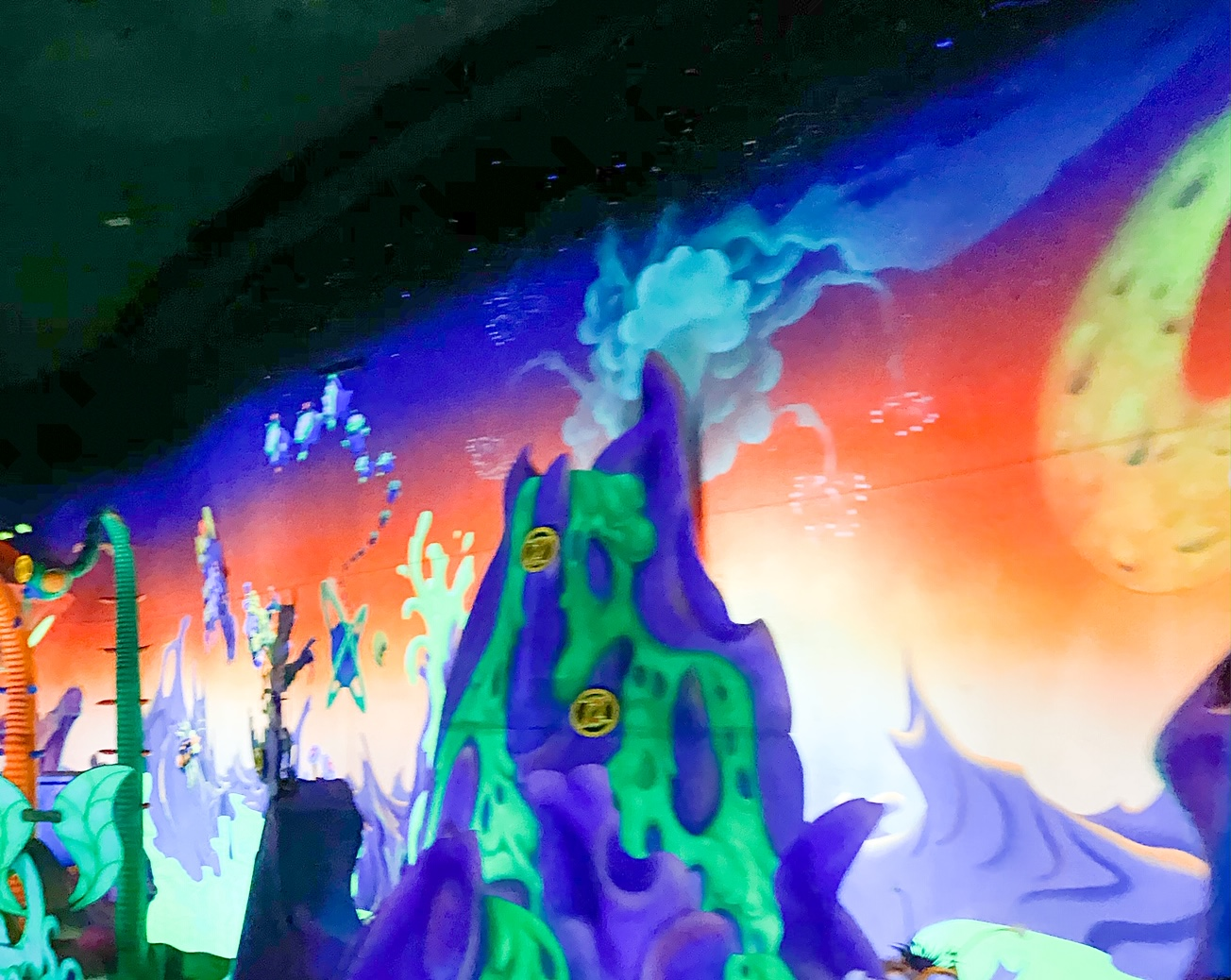 close up view of volcano and scoring on Buzz lightyear ride