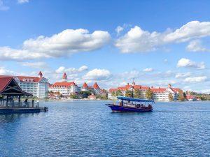 blue boat on water in front of Disney's Grand Floridian Resort Disney transportation