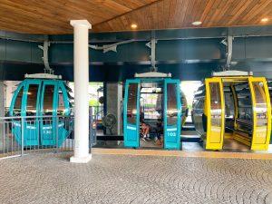 three gondolas of Disney Skyliner in boarding area