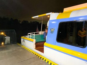 end of yellow and blue Disney boat