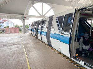 white monorail with blue stripe Disney transportation
