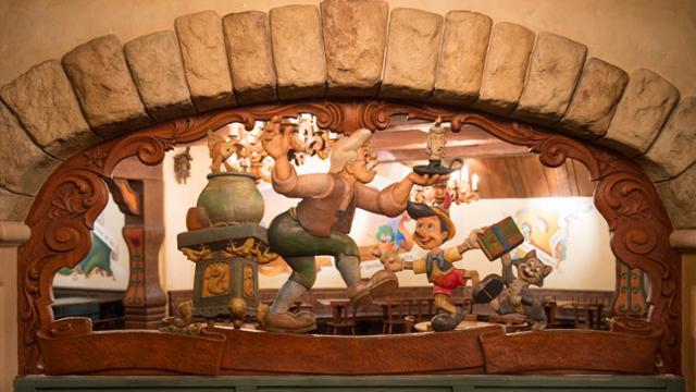A wood carving inside Chalet de la Marrionnette in Disneyland Paris