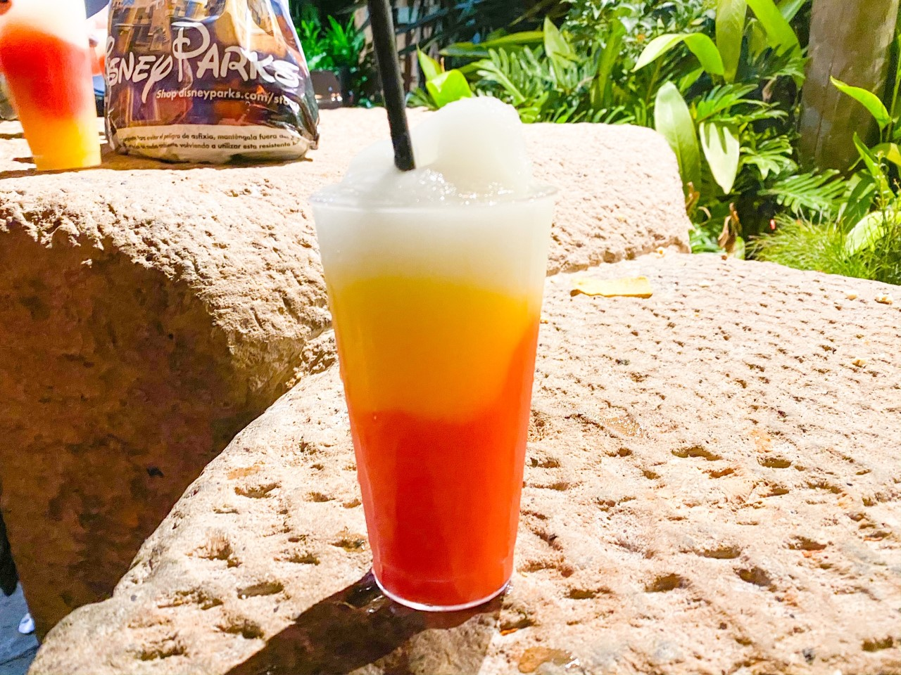photo of a beautiful, colourful drink at Disney; tipping at Disney