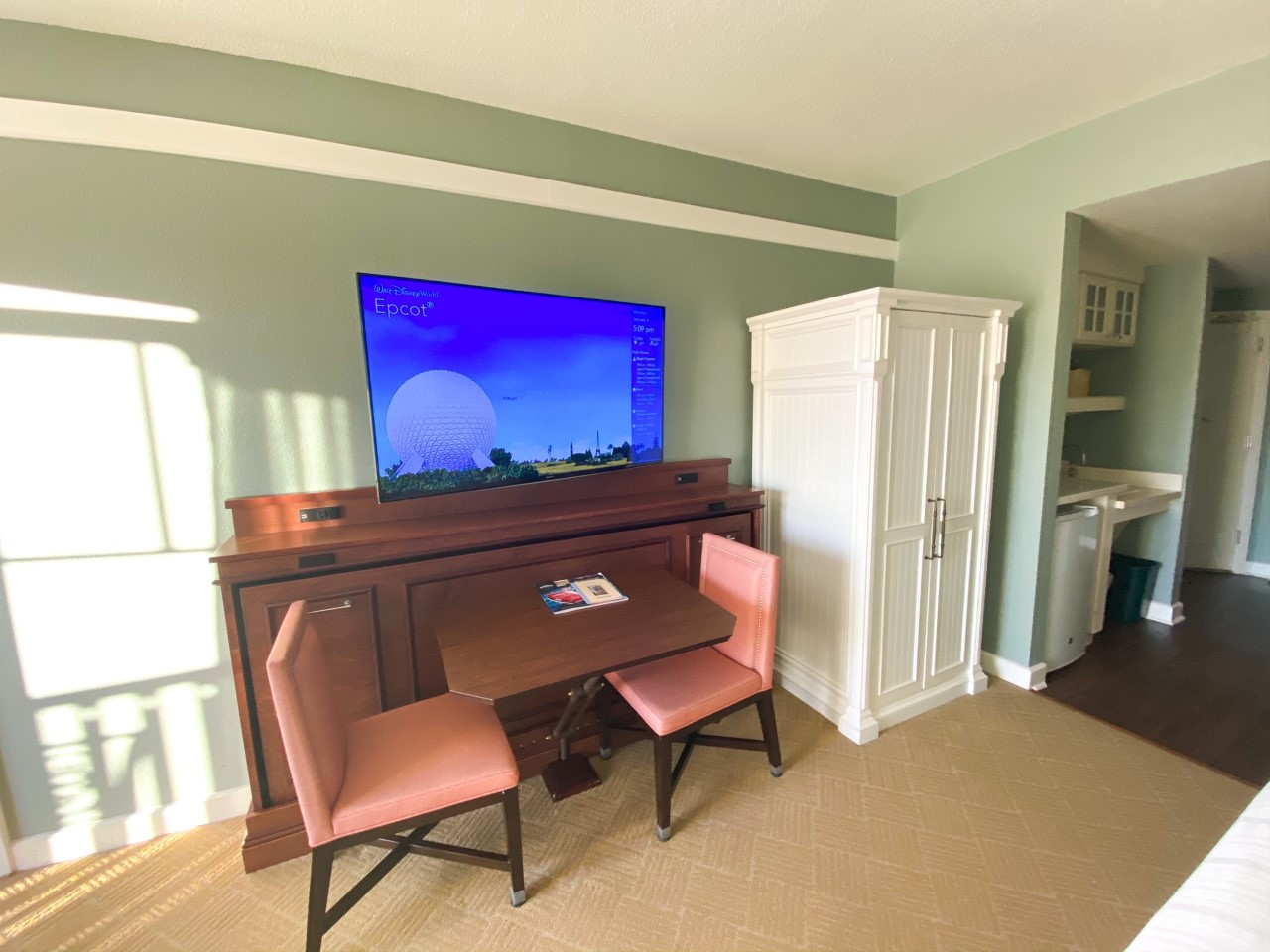 photo of table and chairs in a Disney resort room ideal for in room dining; tipping at Disney